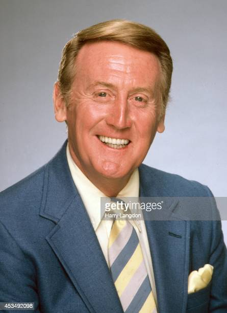 Announcer Vin Scully poses for a portrait in 2002 in Los Angeles, California.