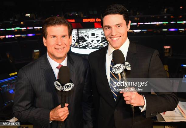 Announcers Jim Fox and Alex Faust pose for a photo before a game between the Calgary Flames and the Los Angeles Kings at STAPLES Center on October 11...