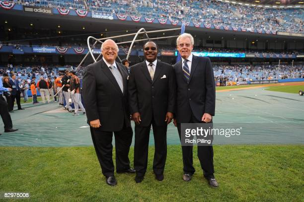 Announcers Jon Miller, Joe Morgan and Peter Gammons on the field prior to the final game ever at Yankee Stadium between the Baltimore Orioles and the...