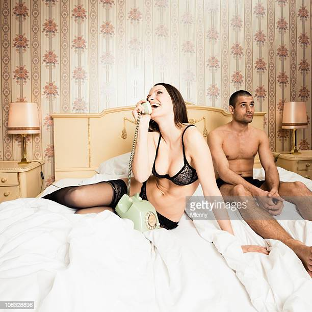 Annoyed Boyfriend and Girl in Lingerie on the Phone