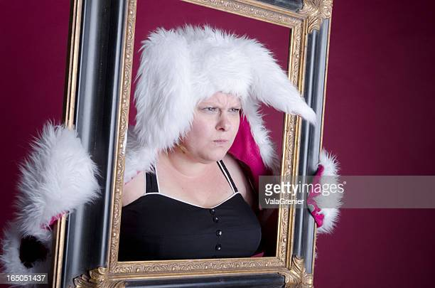 Annoyed Easter Bunny looking through frame.