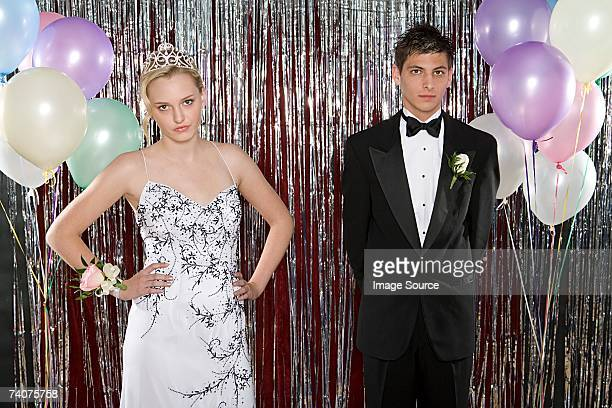 Annoyed girl and boyfriend at prom