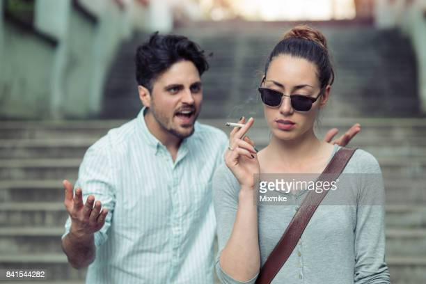 Annoyed looking woman smoking