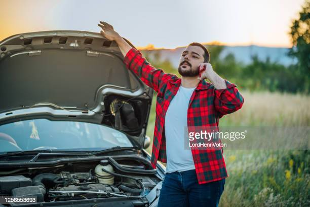 annoyed man calling emergency help - bad luck stock pictures, royalty-free photos & images