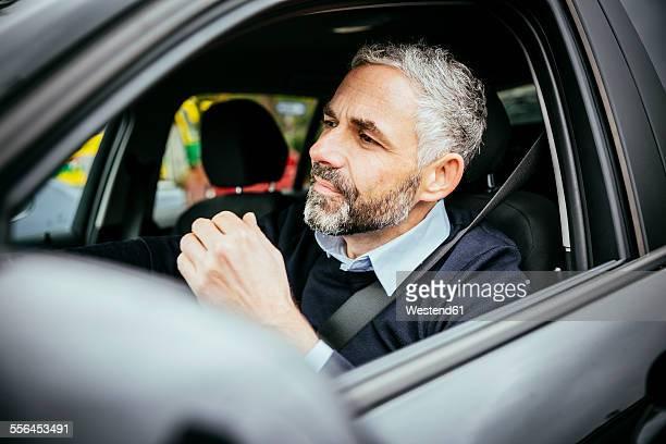 Annoyed man driving car