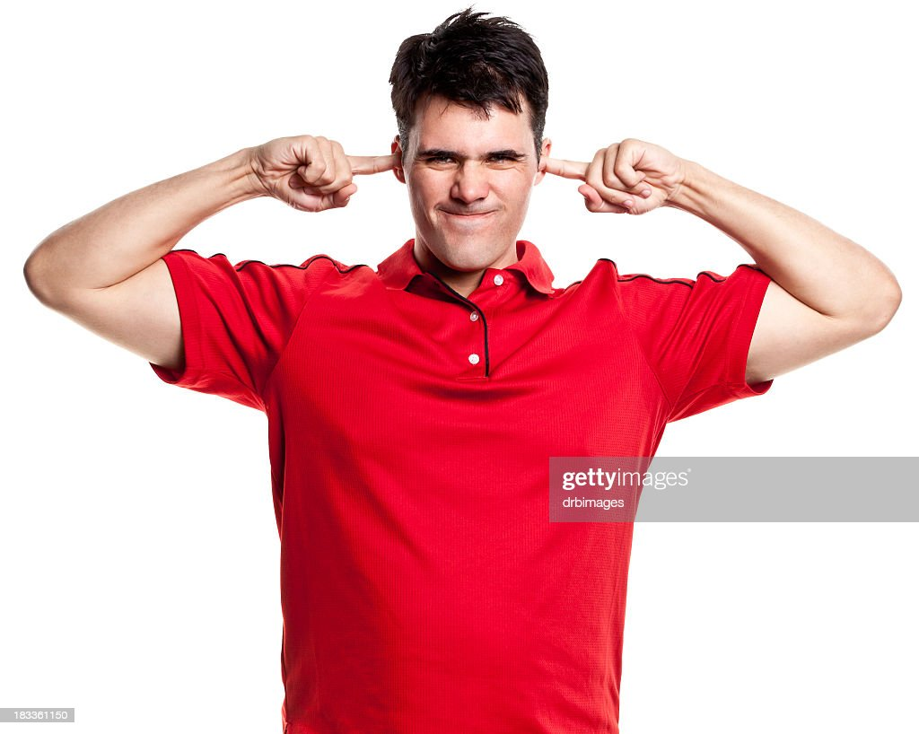 Annoyed Man With Fingers Plugging Ears : Stock Photo