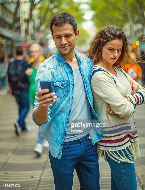 Annoyed woman at texting boyfriend