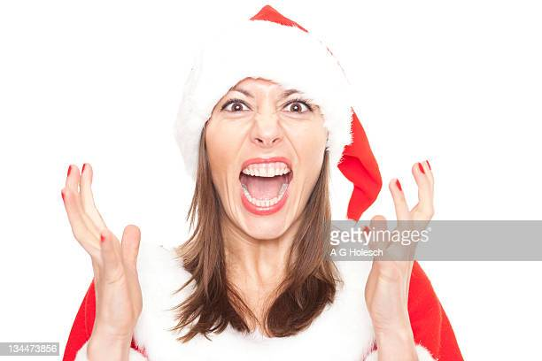 Annoyed woman in Christmas costume, annoying Christmas