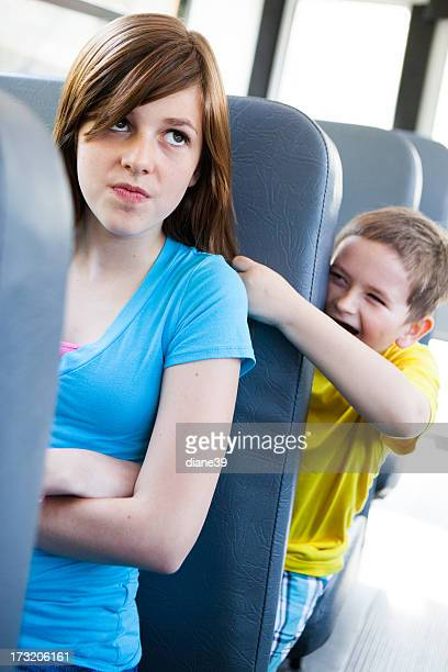 Annoying kid on the school bus.