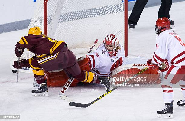 AnnRenee Desbiens of the Wisconsin Badgers makes a split save against Hannah Brandt of the Minnesota Golden Gophers during game two of the 2016 NCAA...