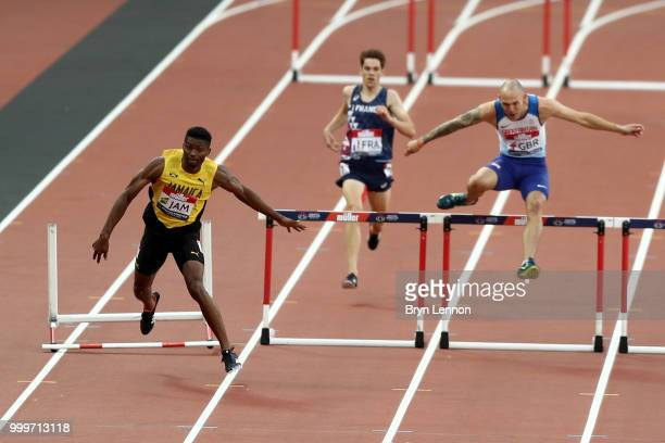 Annsert Whyte of Jamaica trips a hurdle during day two of the Athletics World Cup London at the London Stadium on July 15 2018 in London England