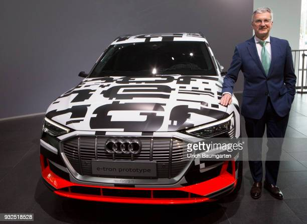 Annual Press Conference of AUDI AG in Ingolstadt Rupert Stadler CEO of Audi AG stands at a etron prototype