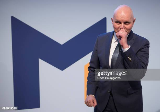 Annual Press Conference of Metro AG Olaf Koch Chairman of the Management Board of Metro AG before the start of the press conference with the logo of...