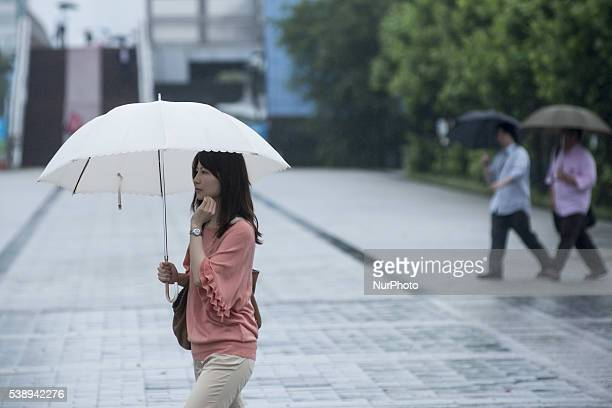 Annual Rainy Season quotTsuyuquot in Japan Tokyo Japan a Pedestrians hold a umbrella under the rain in central Tokyo on June 9 2016 The annual rainy...