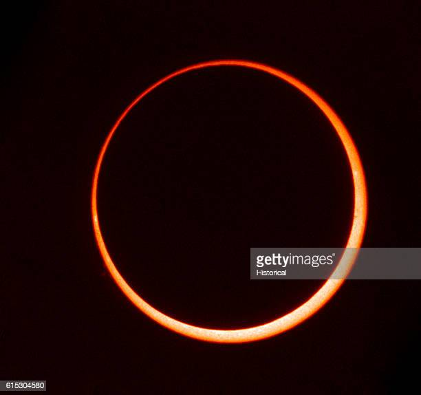 Annular eclipse on May 10 1994 The moon is passing in between the Earth and the Sun obscuring the central part of the sun This leaves a ring of...