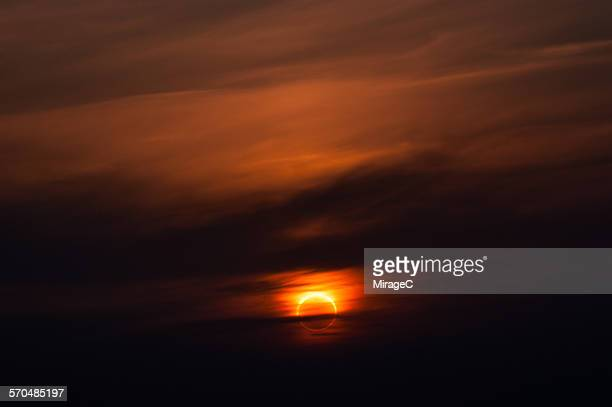annular solar eclipse at sunset - annular solar eclipse stock pictures, royalty-free photos & images