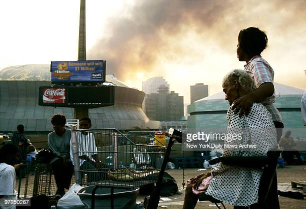 Ann-Veronica Recasner puts her arm around her 90-year-old mother, Mildred Foley, while they wait on an overpass next to the Superdome, in New...