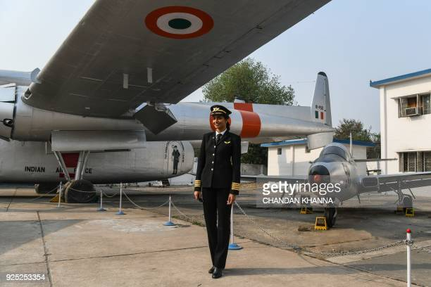 Anny Divya an Indian pilot who became the youngest woman in the world to captain the Boeing 777 aircraft poses next to planes at the Indian Air Force...