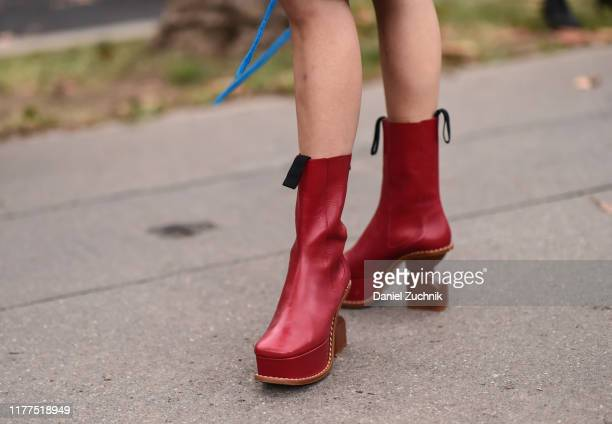 Anny Fan is seen wearing red boots outside the Loewe show during Paris Fashion Week SS20 on September 27, 2019 in Paris, France.