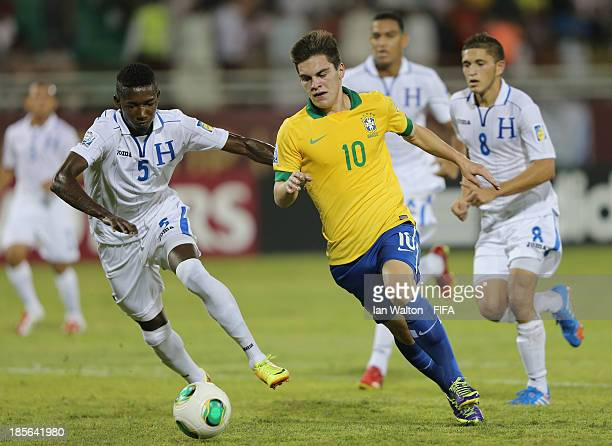 Anoal Hernandez of Honduras tries to tackle Nathan of Brazil during the Group A FIFA U17 World Cup match between Honduras and Brazil at Ras Al...