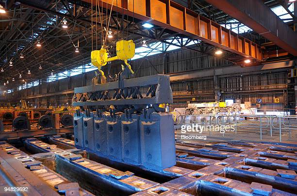 Anode blocks are removed from the ovens by a bridge crane at an Alcoa World Alumina Australia smelting plant partially owned by Alumina Ltd in Point...