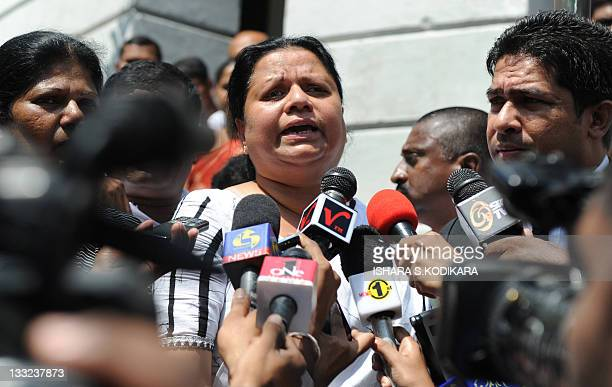Anoma Fonseka the wife of detained former Army chief Sarath Fonseka speaks to reporters outside the Colombo High Court in Colombo on November 18 2011...