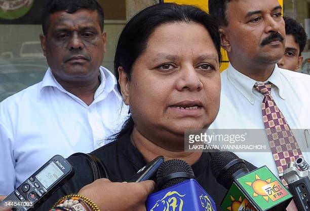 Anoma Fonseka the wife of detained former Army chief Sarath Fonseka speaks to reporters outside a private hospital in Colombo on May 16 2012 Sri...