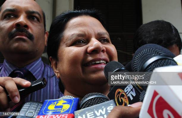 Anoma Fonseka the wife of detained former Sri Lankan Army chief Sarath Fonseka speaks to reporters outside a Colombo High Court in Colombo on May 18...