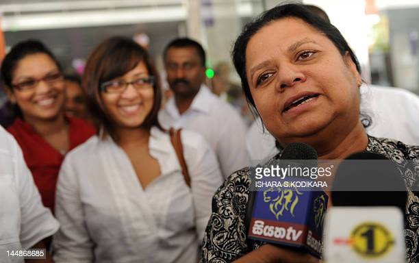 Anoma Fonseka the wife of jailed former Sri Lankan army chief Sarath Fonseka speaks to reporters as their two daughters Apsara Aparna smile with well...
