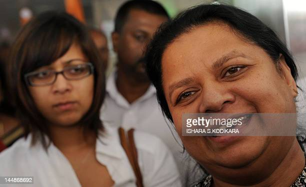 Anoma Fonseka the wife of jailed former Sri Lankan army chief Sarath Fonseka speaks to reporters as their daughter Apsara looks on outside a hospital...
