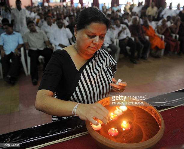 Anoma Fonseka the wife of Sri Lanka's jailed exarmy chief Sarath Fonseka lights a coconut oil lamp seeking divine help to secure the release of her...