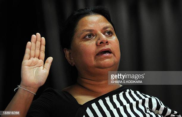 Anoma Fonseka the wife of Sri Lanka's jailed exarmy chief Sarath Fonseka takes a pledge to join The People's Movement to Free Sarath Fonseka during...
