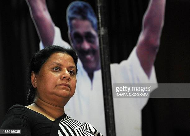 Anoma Fonseka the wife of Sri Lanka's jailed exarmy chief Sarath Fonseka looks on during the inaugural meeting of the group The People's Movement to...