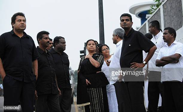 Anoma Fonseka the wife of Sri Lanka's jailed exarmy chief Sarath Fonseka stands outside the main prison in Colombo on September 30 awaiting the...