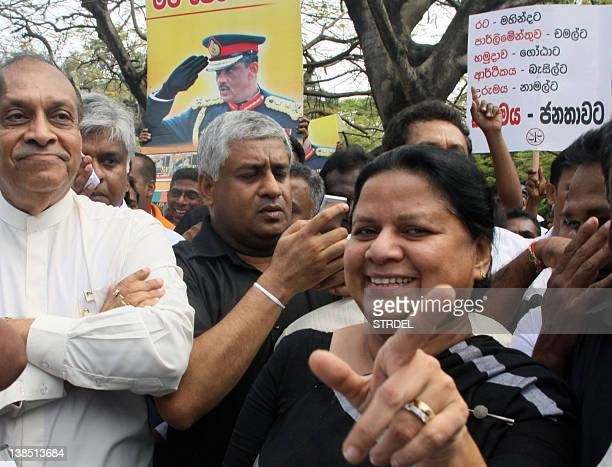 Anoma wife of Sri Lanka's former army disposed army chief Sarath Fonseka gestures during a protest march demanding authorities to release him in...