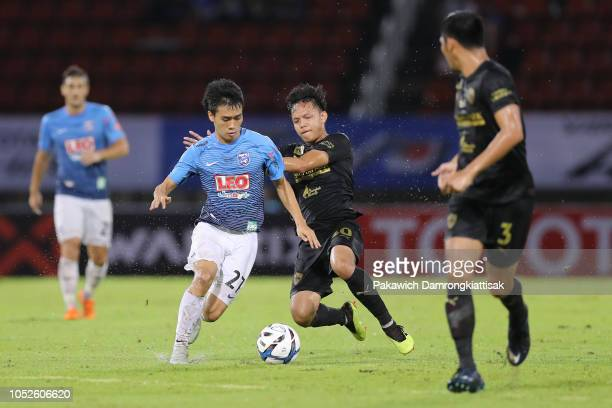 Anon Amornlertsak of Bangkok Glass FC is tackled by Suriya Singhmui of Singha Chiangrai United FC during the Toyota League Cup 2018 Final between...