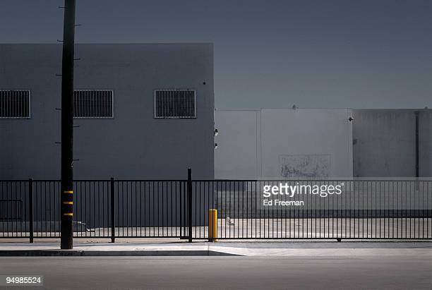 anonymous city street - fence stock pictures, royalty-free photos & images