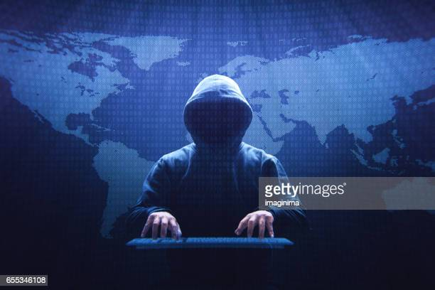 anonymous computer hacker - thief stock pictures, royalty-free photos & images