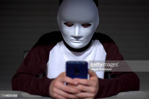 anonymous cyberbullying - anti bullying symbols stock pictures, royalty-free photos & images