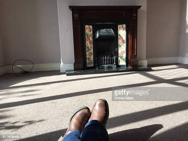 Anonymous person waiting in empty house
