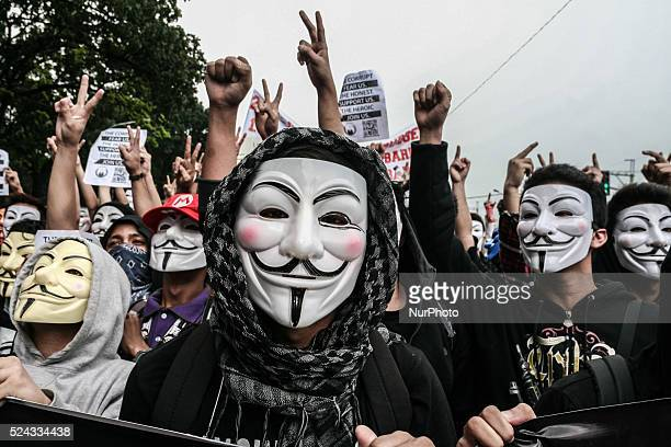 Anonymous Philippines members raise their hands in protest of the current status of the Pork Barrel issue involving several high ranking government...
