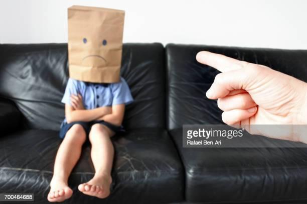 anonymous sad child sitting on a couch - rafael ben ari imagens e fotografias de stock