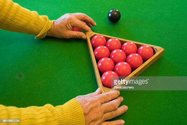 anonymous senior man's hands arranging snooker balls - rack stock pictures, royalty-free photos & images