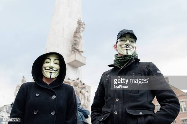 Anonymousinspired activists are taking to the streets of Amsterdam on November 5 as part of a global movement Hiding behind symbolic Anonymous masks...