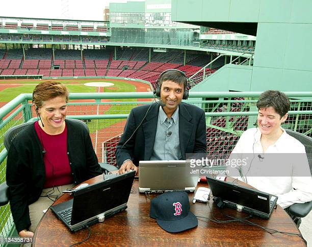 Anoop Gupta corporate vice president at Microsoft sits on top of the 'Green Monster' in Boston's Fenway Park September 15 2003 with Corinne Martinez...