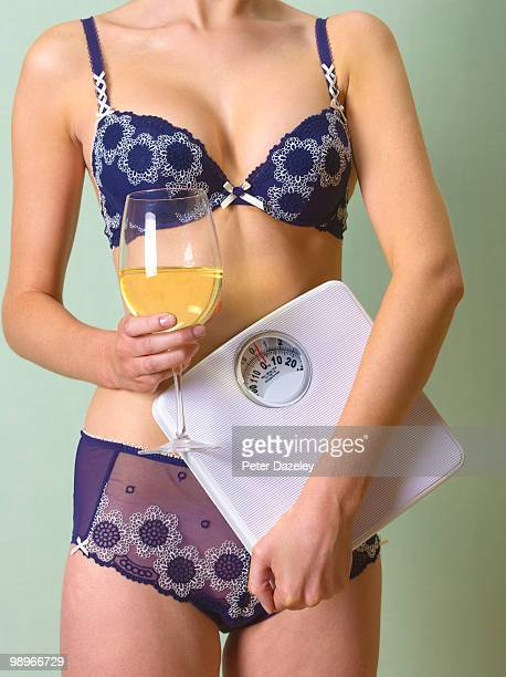Anorexic girl controlling her weight by drinking