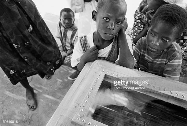 Another child is left without a father in Homa Bay Kenya AIDS has orphaned 15 million African children in the last twenty years It is estimated that...