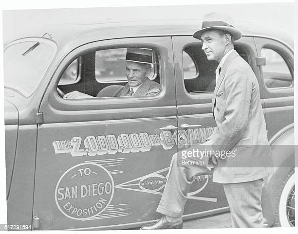 Another Ford Production Mark. Henry and Edsel Ford with the 2 000th V-8 Ford car, which recently came off the assembly line and will be driven to San...