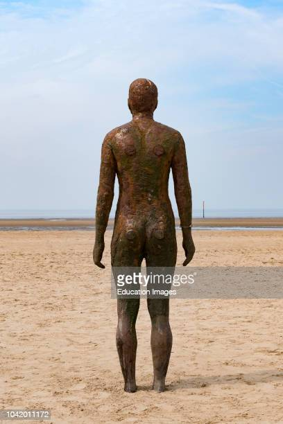 Another Place a modern art installation on Crosby beach Liverpool uk by sculptor Antony Gurley