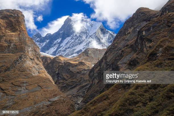 another side of the peak of machhapuchhre during the trekking trail to annapurna base camp (abc) near deurali village, nepal. - copyright by siripong kaewla iad stock photos and pictures